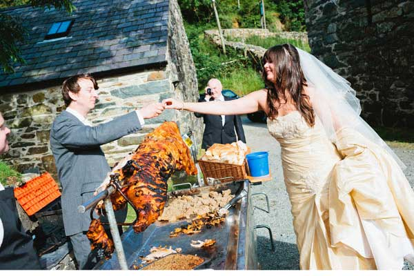 a hogroast for the bride and groom outside the llyn