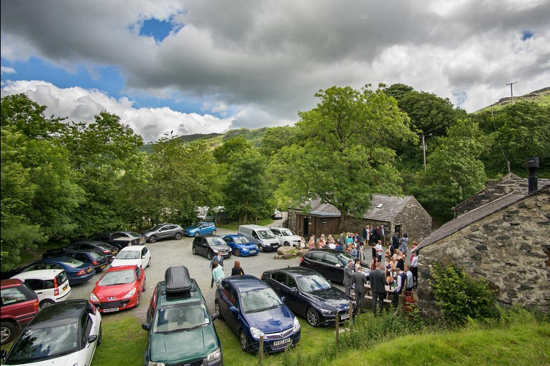 guests park in barn yard for a wedding llyn gwynant campsite