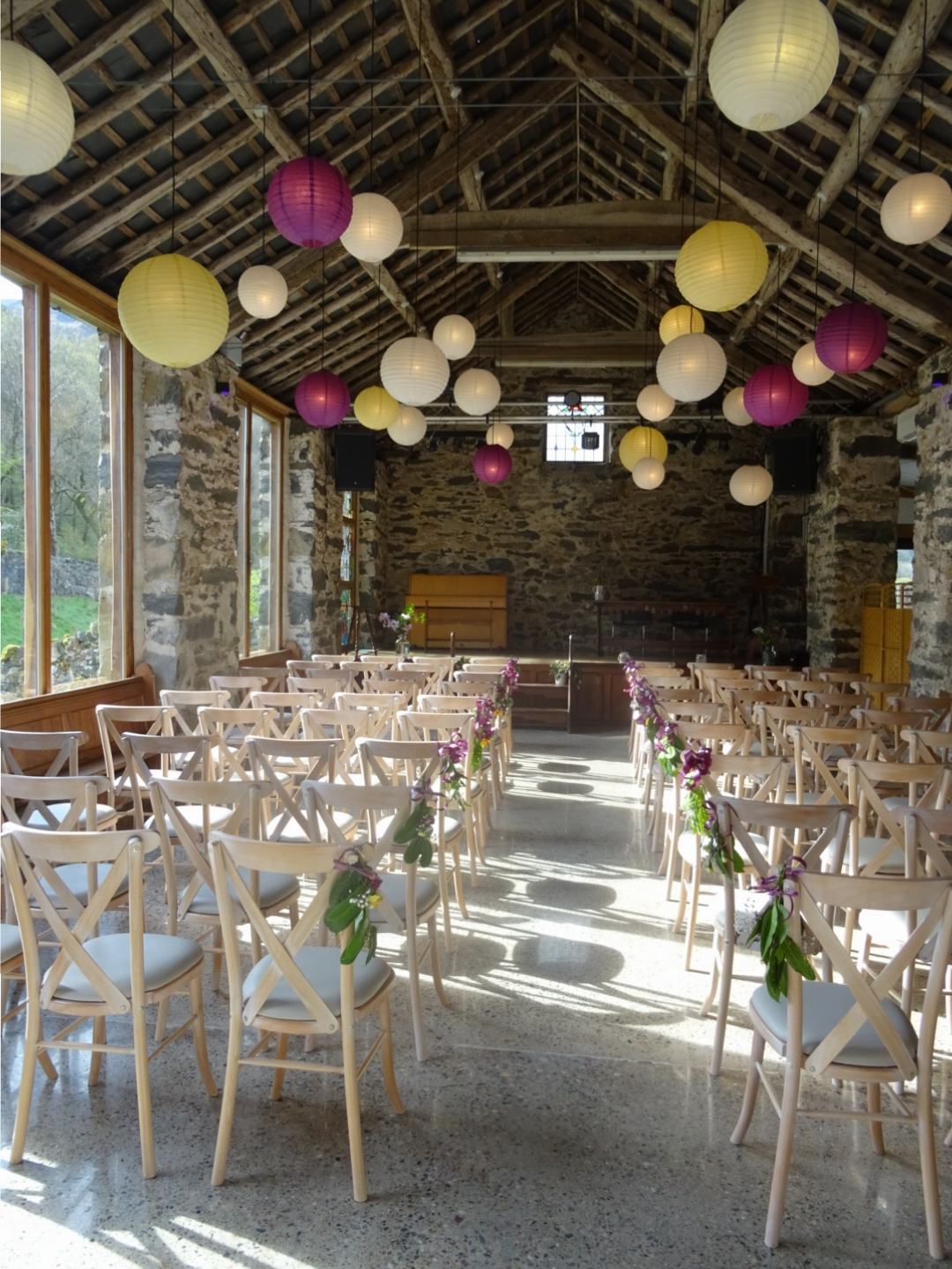 light fills the big barn as it is prepared for a wedding