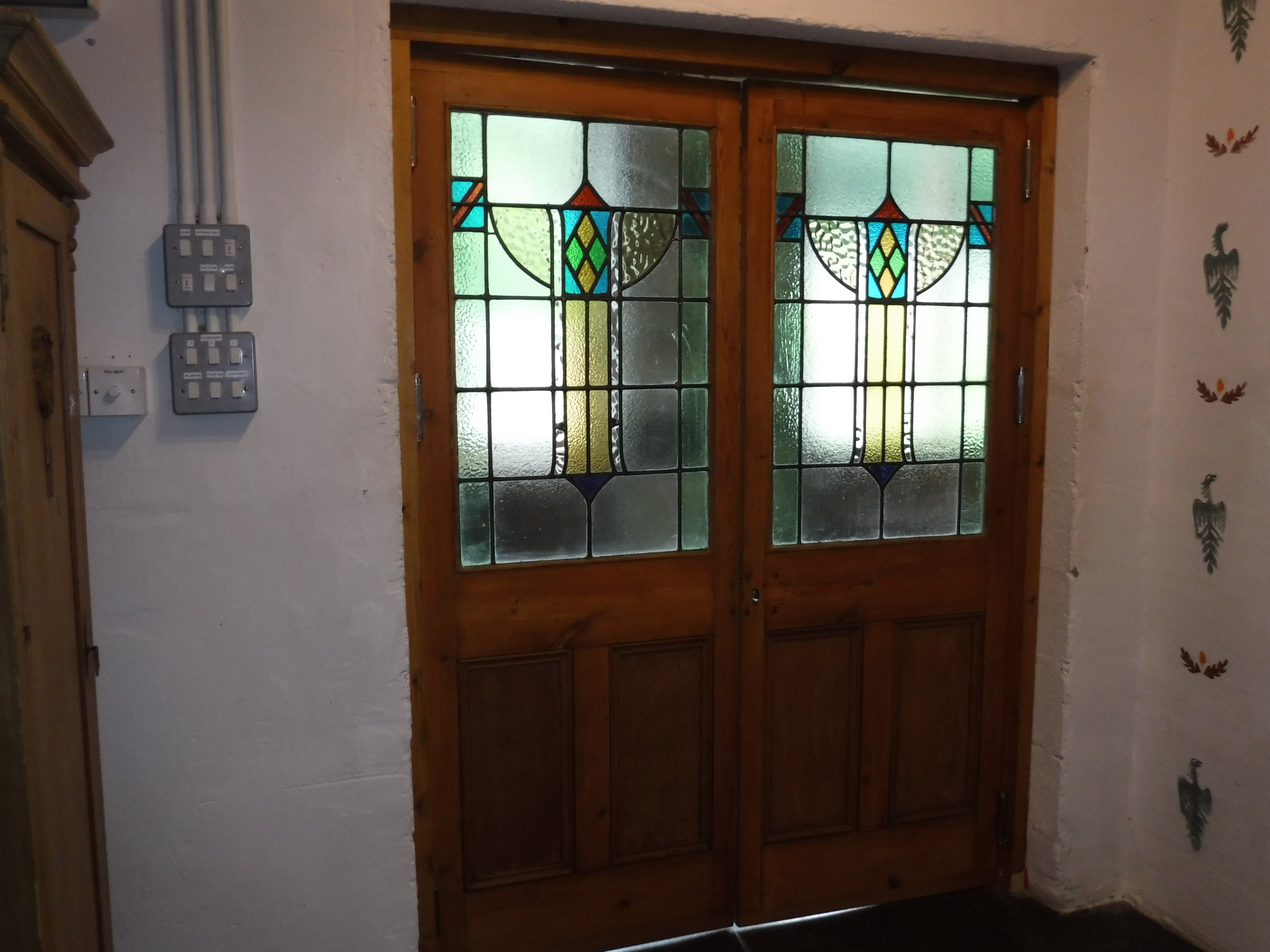 Elegant Doors With Stained Glass Lead Into The Tall Barn Llyn