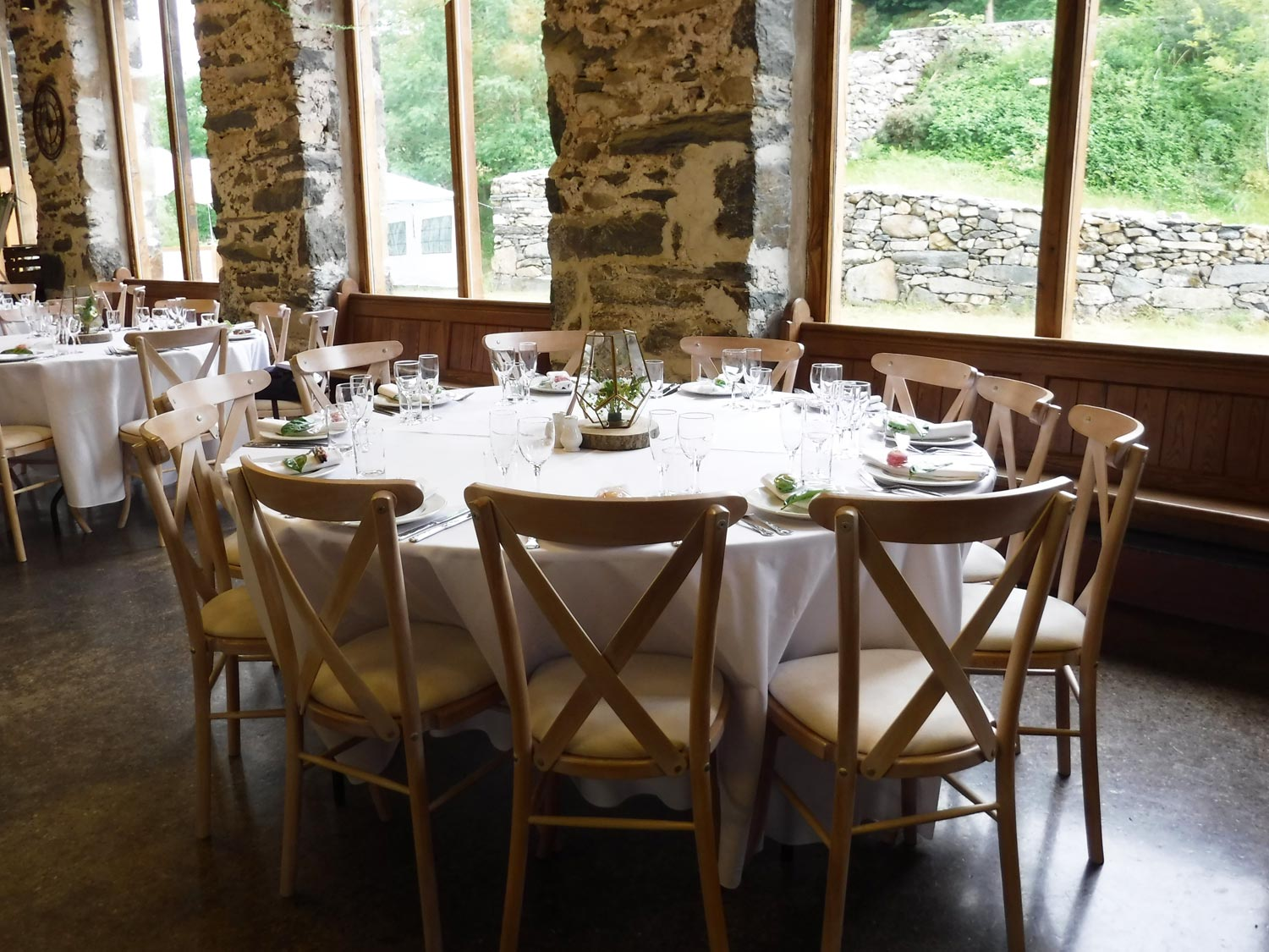 A Round Six Foot Table In The Function Barn With Our Wedding Chairs