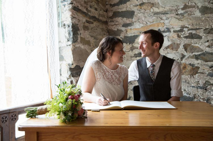 a bride and groom in llyn gwynant barns llyn gwynant