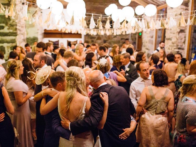 guests in big barn celebrate a wedding llyn gwynant campsite