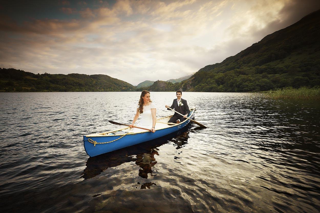 bride and groom afloat in llyn gwynant after their wedding